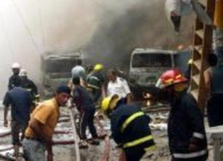 At least 19 people have been killed in two car bomb explosions in the Iraqi capital, Baghdad