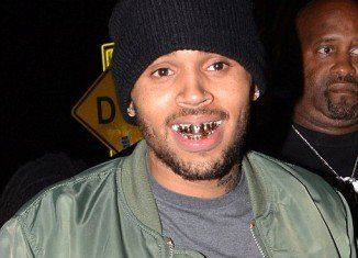 Chris Brown joined other rappers in the trend by proudly flashing his golden chompers to the dancing crowds at AV Nightclub