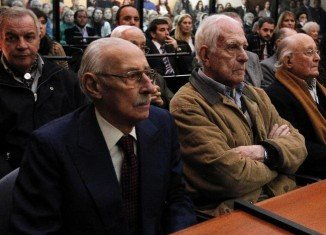 Former leaders during Argentina's military rule Jorge Videla and Reynaldo Bignone have been found guilty of overseeing the systematic theft of babies from political prisoners