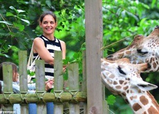 Katie Holmes appeared to be beaming yesterday as she took her daughter Suri Cruise on a trip to the Bronx Zoo