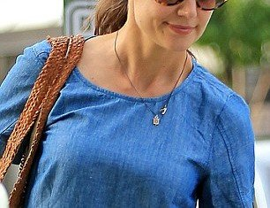 Katie Holmes has turned her back on the controversial religion of Scientology by registering with a Catholic church in New York