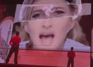 Madonna has spoken about an image used during her current MDNA tour which showed a swastika imposed onto the face of French politician Marine Le Pen