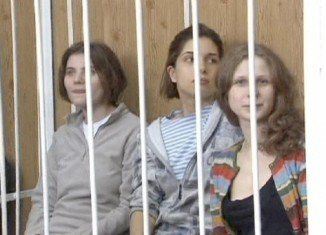 """Nadezhda Tolokonnikova, Maria Alyokhina and Yekaterina Samutsevich caused outrage when they sang a song that implored the Virgin Mary to """"throw Putin out"""" in February"""