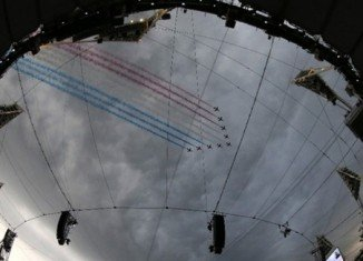 Thousands of people awaits the spectacular opening of the London Games, as a fly-past by the Red Arrows marked the start of the pre-show