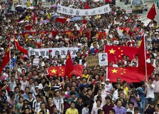 Anti-Japanese protests took place in cities across China after Japan's nationalists raised their country's flag on disputed islands