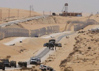 At least 13 Egyptian policemen have been killed by unidentified gunmen who attacked a checkpoint on the Egyptian-Israeli border