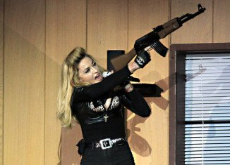 Catholic and veterans groups in Poland are protesting against Madonna's concert in the Polish capital because it falls on the anniversary of the Warsaw Uprising
