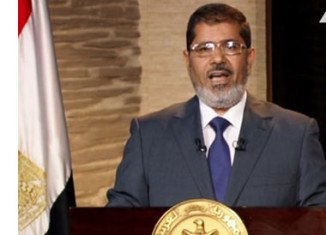 Egypt's President Mohammed Mursi has told Non-Aligned Movement (NAM) summit in Iran that the Syrian uprising is a revolution against an oppressive regime