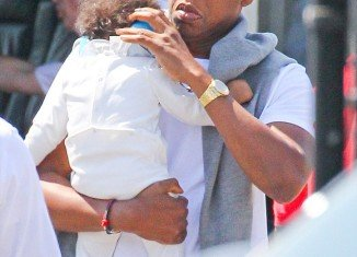 Eight month old Blue Ivy Carter has been seen being fussed over by her very proud father, the legendary Jay Z, as they jet into Manhattan by helicopter