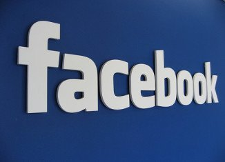Facebook will allow app developers to advertise their products on its members' mobile-device news feeds