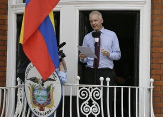 """Julian Assange has urged the US to end its """"witch-hunt"""" against WikiLeaks, in his first public statement since entering Ecuador's London embassy"""