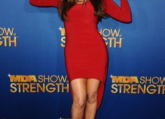 """Khloe Kardashian looked sizzling in a red """"mullet"""" dress as she arrived at the MDA Labor Day Telethon in Los Angeles last night"""
