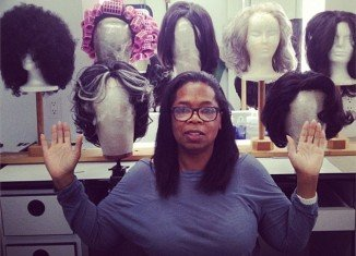 Oprah Winfrey showed off her vast selection of wigs on the set of her new film The Butler