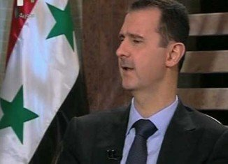 """President Bashar al-Assad has said Syrian government needs more time to """"win the battle"""" against rebel forces"""
