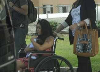 Snooki was spotted leaving hospital yesterday, two days after giving birth to her son Lorenzo
