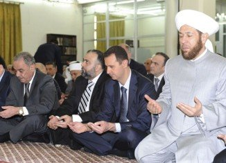 Syrian state TV showed Bashar al-Assad performing prayers in the capital's al-Hamad mosque at the start of the Eid al-Fitr festival marking the end of Ramadan