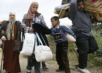 The United Nations refugee agency says that more than 200,000 Syrians have fled to neighboring countries as the conflict has intensified