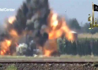 A warplane has attacked a petrol station in the north-east of Syria, killing at least 30 people