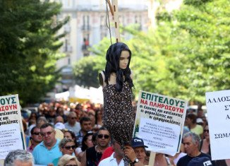 Greek governing coalition agreement comes the day after 50,000 anti-austerity protesters took to the streets of Athens