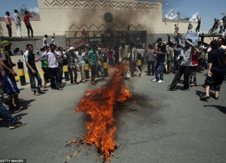 In Yemen, demonstrators briefly stormed the grounds of the US embassy in Sanaa and burnt the US flag
