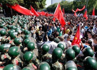Japan will seek compensation from China for damages to its diplomatic missions there during protests over disputed islands