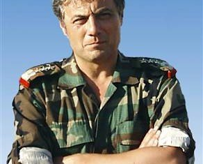 Key Syrian defector General Manaf Tlas has hinted that French secret agents helped him flee Syria in early July