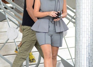 """Kim Kardashian covered her famously curvaceous figure in a grey sleeveless """"skorts-suit"""" while shopping in Miami Beach"""