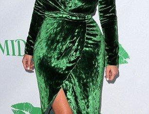 Kim Kardashian looked fantastic in her green velvet wrap dress from the front