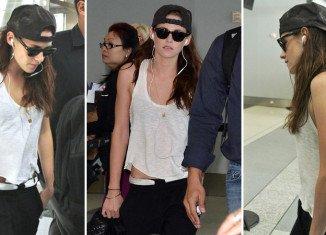 Kristen Stewart was wearing a baseball cap belonging to her estranged boyfriend Robert Pattinson as she jetted out of Toronto