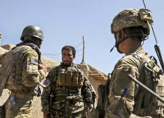 NATO announces that it is restricting operations with Afghan troops following a string of deadly attacks on its personnel by rogue Afghan security forces
