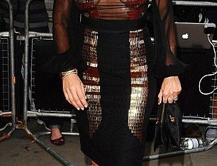 Nancy Dell'Olio was surely the Mess of the Year after stepping out in a hideous outfit at the GQ Men of the Year Awards 2012 in London