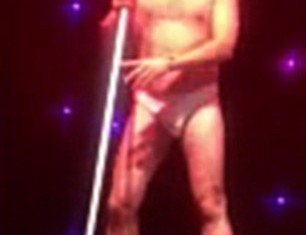 Simon Gregson crashed the stage at Manchester's Hilton Hotel in just a thong