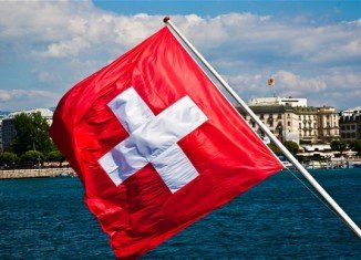 Swiss citizens are going to the polls to vote on a proposal to ban smoking completely in enclosed public places