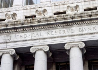 The US central bank has announced it will resume its policy of pumping more money into the economy via so-called quantitative easing