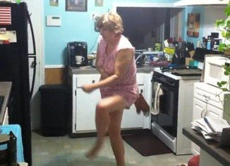 The hysterical video, uploaded on YouTube, shows the pajama-clad woman wandering and then waltzing around her kitchen, while her son follows her with a camera