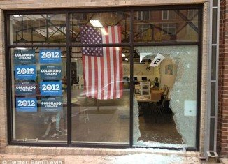 A large panel of glass was left shattered at Barack Obama's campaign office on West Ninth Avenue near Acoma Street in Denver