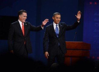 Barack Obama and Mitt Romney have clashed over their economic plans at Denver debate