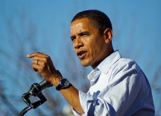 Barack Obama will be the first president to vote early, as part of a two-day campaign marathon across eight states