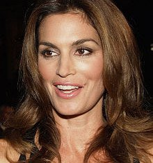 Cindy Crawford has revealed her secret to looking youthful is to wear less make-up