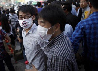 Crowds attacked police and overturned cars in Ningbo on Friday night after a week of protests against pollution