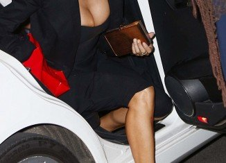 Elisabetta Canalis almost gave onlookers in Milan more than they bargained for after her ample assets almost spilled out of her top