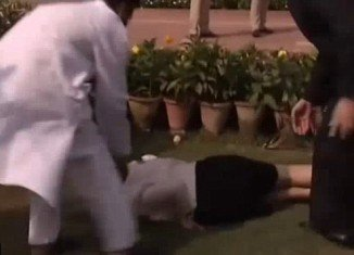 Julia Gillard fell flat on her face when her heel became stuck in the grass