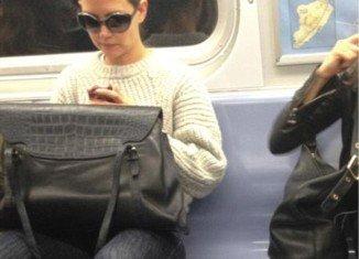 Katie Holmes rides the subway