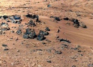 NASA's Curiosity rover is preparing to scoop its first sample of Martian soil