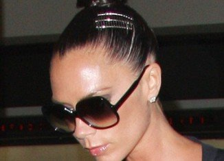 """Popular with Victoria Beckham and Katie Holmes, topknots pull the forehead taut giving wearers a """"naturally"""" Botoxed appearance"""