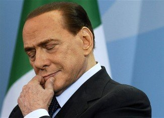 """Silvio Berlusconi has said he feels """"obliged"""" to stay in politics, a day after receiving a jail term for tax fraud"""
