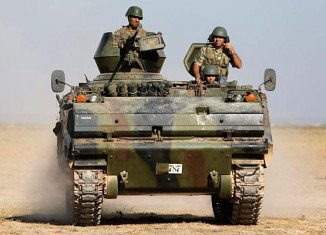 Turkish military has returned fire across the border after a Syrian mortar round again landed on Turkey soil