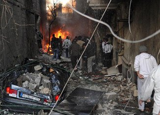 At least 34 people have been killed and many injured by two car bomb explosions in Jaramana, a south-eastern district of Damascus