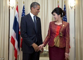 Barack Obama is practicing a new brand of foreign relations, appearing to flirt with Thai PM Yingluck Shinawatra