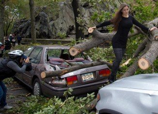 Brazilian glamour model Nana Gouvea has been slammed for posing against the trail of destruction left by Hurricane Sandy